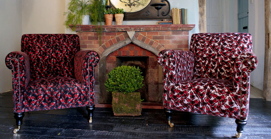 Arm chairs by fireplace
